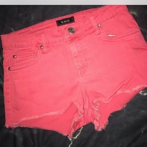 Pink cutoff shorts